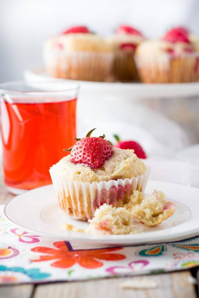 Soft and tender, playful and joyful, quick and easy strawberry coconut muffins. The perfect way to start your day or enjoy all day long. Light on sugar, filled with a delicious combination of sweet strawberries and shredded coconut!