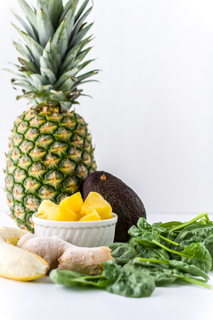 Healthy Green Smoothie recipe with a sweet pineapple and bananas. A great way to boost your immune system and overall health. Drink this multivitamin to energize your body and feel good the whole day.