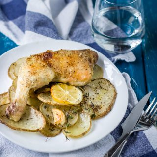 Roasted chicken legs with lemon and potatoes recipe. Thyme and lemon brings a lot of fresh aroma and taste into this simple, delicious dish. For busy rough days just add a glass of wine and enjoy this rustic comfort dinner to the fullest. Bon Apetit!