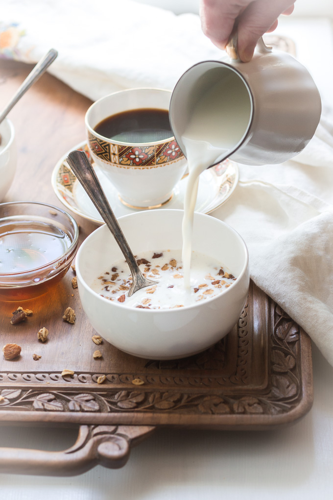 Homemade coffee granola with winter spices is the perfect way to start your day. This granola is like eating a slice of a gingerbread with the cup of freshly brewed coffee, but a lot healthier.