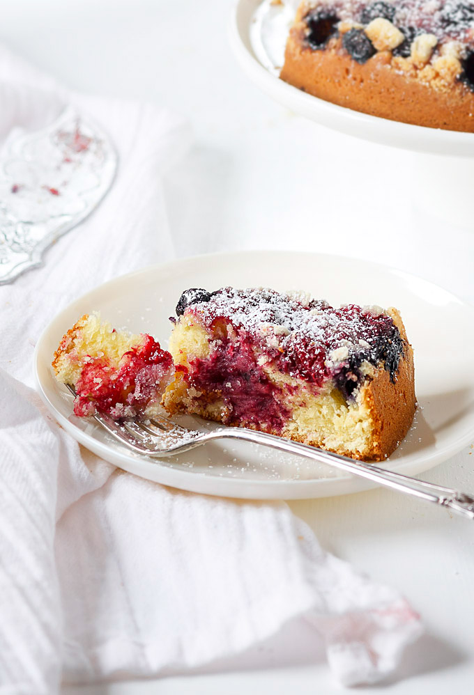 This effortless mixed berry cake recipe is perfect for any occasion or when you need a little extra cheer me up treat. Super easy and fast to make, AND low on sugar. The delicate sweet and tangy taste, the melt in your mouth buttery texture, and the pop of different colors are worth your time.