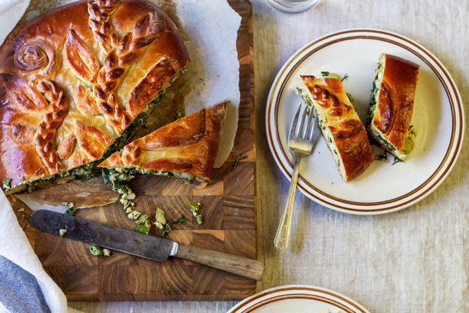 This Ukrainian savory egg and fresh herbs pie is a family recipe and one of my favorite pies from the childhood. The combination of fresh eggs from a local farm and fragrant seasonal dill, parsley and scallions wrapped in a soft, lightly sweetened yeasted dough will make you fall in love with this recipe.