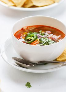Easy and Healthy Smoky rotisserie chicken soup recipe to use any leftover rotisserie or cooked chicken. Warming, comforting and healthy way to nourish you for lunch or dinner. #rotisseriechicken #soup #chickensoup #healthy #recipe