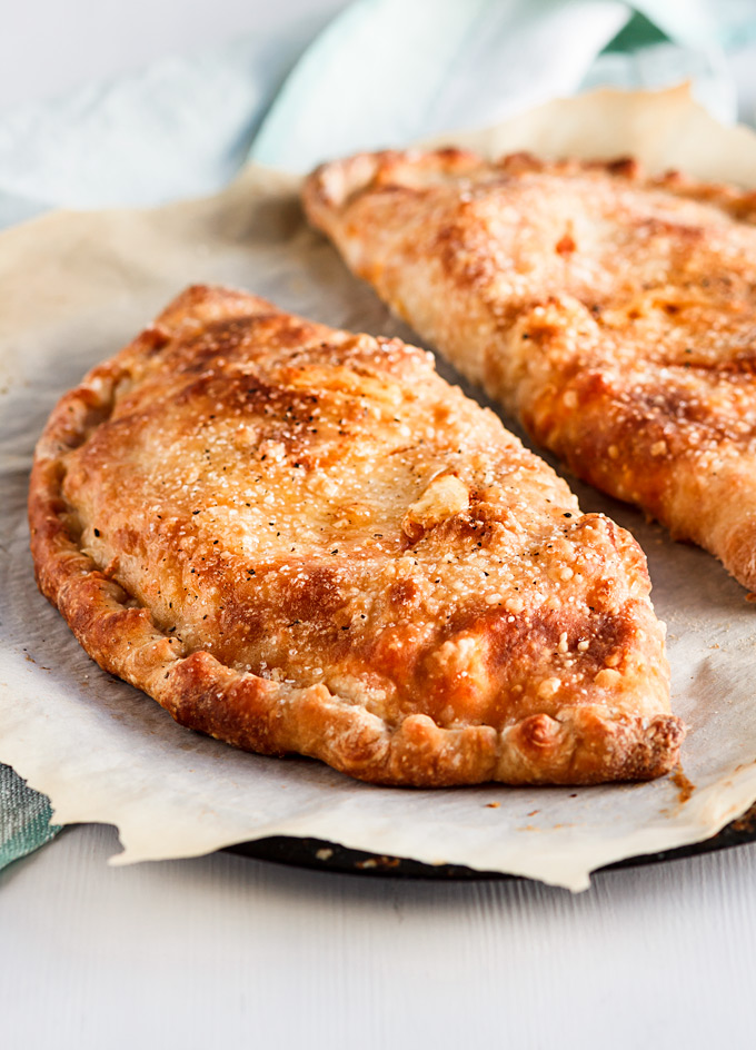 This buffalo rotisserie chicken calzone recipe is a part of my 5 Easy Recipes with leftover rotisserie chicken project. It is easy to make, fast to put together and a fun dinner to enjoy on the weekends or when you crave for some not so healthy food. You will also learn a lot of Tips and Tricks on how to make a perfect calzone with any filling in the comfort of your home. #calzone #buffalosauce #rotisseriechicken #chicken