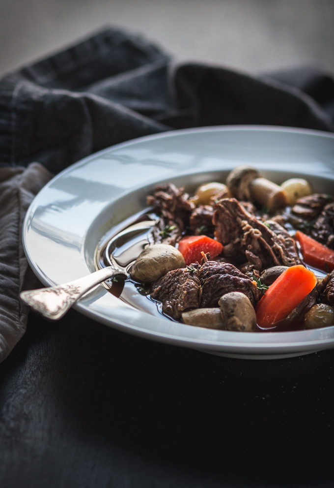 This Irish Guinness Beef Stew recipe is a simple and light dish to celebrate St. Patrick's Day. I eliminated all unnecessary fat and other heavy stuff to make it a healthier dinner. Enjoy it with crusty bread to soak all the flavorful Guinness broth. #beef #stew #guinness #dinner #stpatricksday