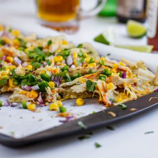 Quick and easy rotisserie chicken nachos recipe. In this post, you will learn how to make chicken nachos with rotisserie or any cooked shredded chicken. This is lighter nachos where I omitted heavy cheese sauce. Instead, I used only cheese and hot sauce to create healthier buffalo chicken nachos recipe. #nachos #chickennachos #rotisseriechicken