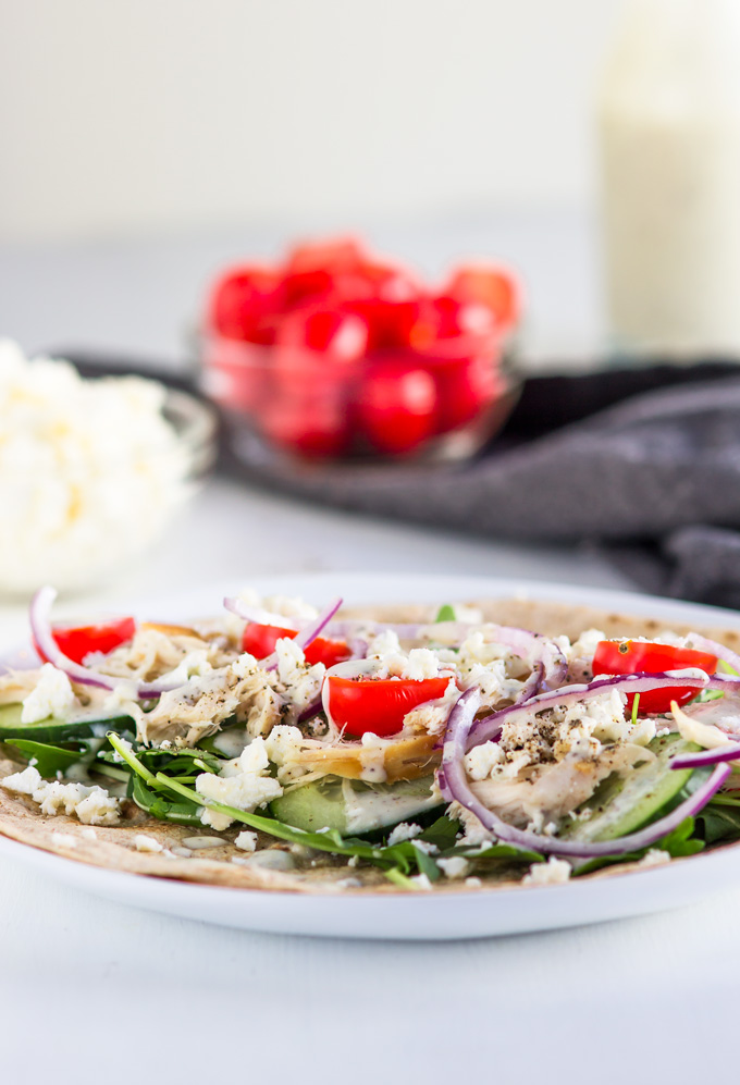 This Rotisserie chicken wrap with Greek yogurt dressing is a saver for busy weeks. When you work too many hours and don't have enough energy to prep meals this chicken wrap will save your day. It is super easy to make, includes light and healthy ingredients, and you need about 10 minutes to put everything together! #chicken #wrap #rotisseriechicken