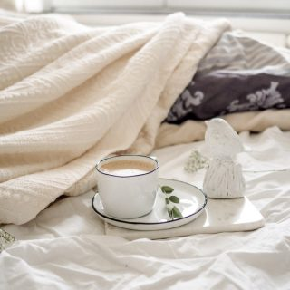 Coffee in bed on a cozy morning. This picture is a part of Weekend Planner Things To Do and Thoughts To Share post from The Pure Taste Blog.