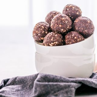 This easy to make, no bake chocolate energy balls recipe is vegan, gluten-free and refined sugar-free. No baking is required! Simply put all ingredients in a food processor, and after a couple of pulses, you have a perfect healthy snack to keep you awake throughout the day and weeks. These healthy energy balls are made with dates, nuts, coconut, cacao and some extra nutritious add-ons. Once you learn how to make energy balls, you will never buy one again. #energyballs #enerybites #energybars
