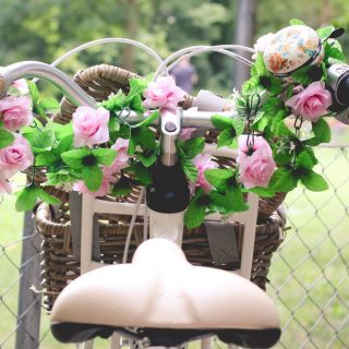 Cute bicycle with flowers in the basket. This picture is a part of Weekend Planner Things To Do post from The Pure Taste Blog. Weekend planner things to do and thoughts to share is a post where I share my weekly highlights. I hope you will find here some inspiration and new ideas how to spend your weekend, day-off or a date night. I also share some useful information to make our lives better, healthier and filled with fun and happiness. #weekend #weekendplanner #dayoff