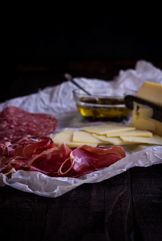 Italian charcuterie board. Antipasto selection for the Muffuletta sandwich recipe. #antipasto #charcuterie