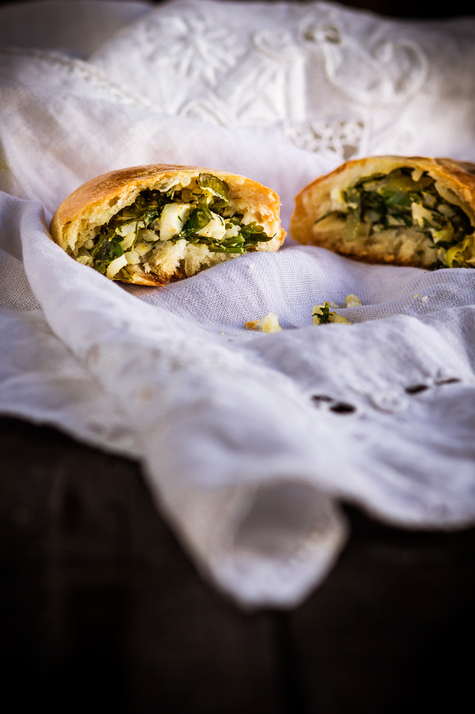 In this post, you will learn how to make authentic Ukrainian piroshki recipe. In English- fresh herbs, egg and rice vegetarian hand pies. Piroshki, pirozhki, pyrizhky are both sweet and savory hand pies made from yeasted dough and are an essential part of the Ukrainian and Russian cuisine. This is the family best piroshki recipe, and I'm very excited to share it with you. And as always in the post, I share some tips and tricks on how to make piroshki from scratch. #piroshki #handpies #savoryhandpies