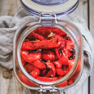 In this recipe, you will learn how to make oven roasted peppers. Oven roasted bell peppers are super easy to make, very delicious and so versatile. Make one batch of homemade roasted red peppers and use it different dishes or eat it straight from a jar! #roastedpeppers #bellpeppers