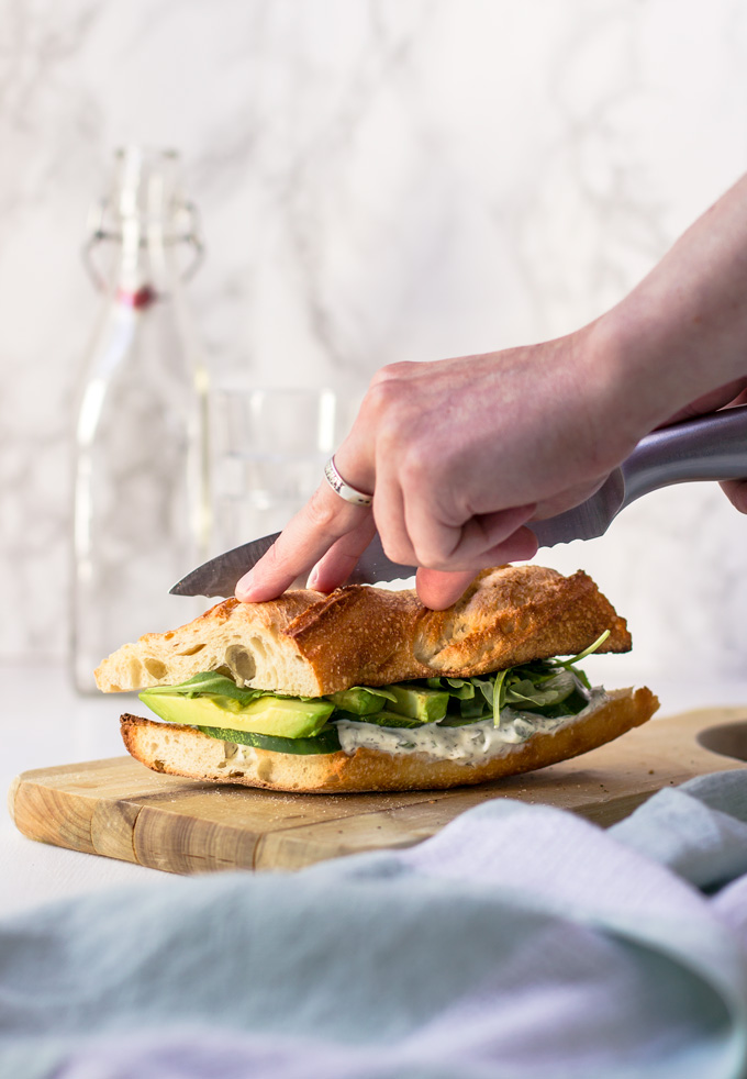 Beautiful and delicious vegetarian cucumber and avocado sandwich recipe. In about 15 minutes you have a healthy vegetarian sandwich full of flavors and vitamins to enjoy any time of the day. Even though it is a veggie sandwich, it will keep you full and satisfied for many hours. Grab this green goddess sandwich recipe and make it for breakfast, lunch or even dinner. Enjoy ;) #sandwich #vegetarian #veggierecipe #avocado