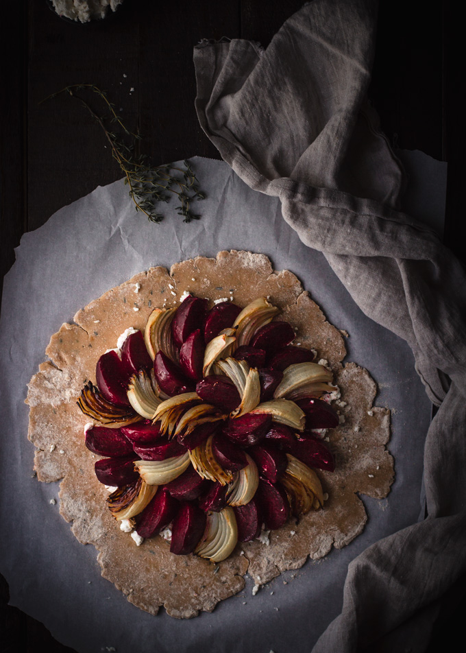 This rustic roasted beets and goat cheese galette will prove that beets can be delicious and fancy. In this recipe, you will learn how to cook beets the right way, how to make 100% white whole wheat crust and how to use the underdog vegetable to create the beautiful savory galette. If you are looking for the beets recipe, then give this beet and goat cheese pie – galette a chance. #pie #galette #beets #savory #goatcheese