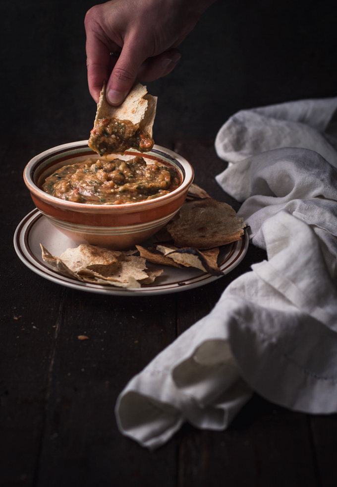 This roasted eggplant dip recipe is our favorite way to use seasonal eggplants. A family recipe called eggplant caviar - Ukrainian and Russian authentic food. Roasted eggplant with a smoky hint combined with fresh raw vegetables makes an irresistible dip or eggplant spread, depends on how you like to eat it. On top of that, this is 100% healthy and vegan eggplant dip! #eggplant #dip #spread #eggplantrecipes